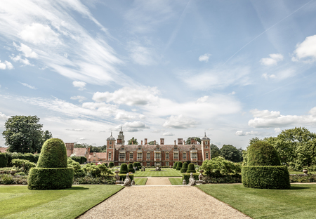 View of part of the gardens of the large manor house of Blickling Hall in the village of Blickling north of Aylsham in the county of Norfolk, England, United Kingdom 免版税图像 - 109447227