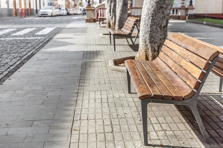 Several empty wooden benches in a park
