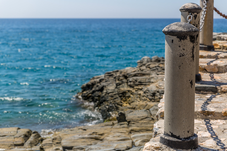 Metal bollards and chains to make a barrier in a coastal area of southern Spain, Almunecar, Spain Standard-Bild