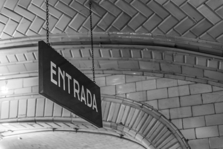Entrance sign in an old subway station, in the city of Madrid, Spain