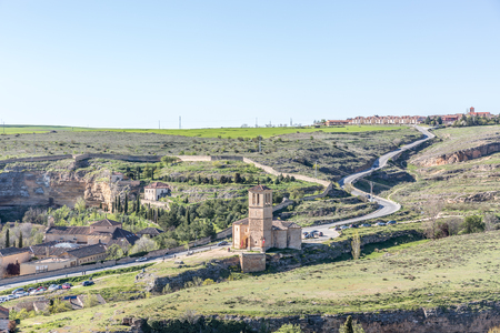 View of a landscape on the outskirts of the city of Segovia, with some religious buildings, Spain