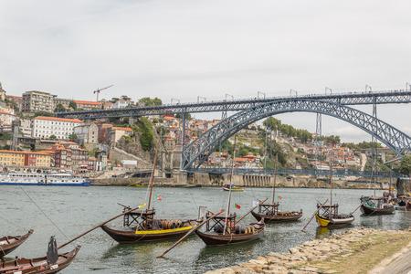 Old Porto cityscape skyline, traditional boats with wine barrels and Douro River in Porto, Portugal