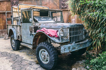 Old gray 4x4 retro style car very poorly preserved