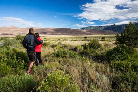 dunes: Young couple in Great Sand Dunes Park Stock Photo