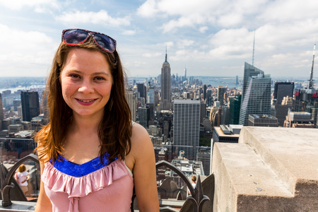 uptown: Girl taking selfies with view to Uptown Manhattan