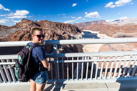 mead: Girl in front of Hoover Dam and Lake Mead Stock Photo