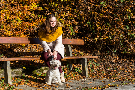 poodle: Girl with a poodle in forest Stock Photo