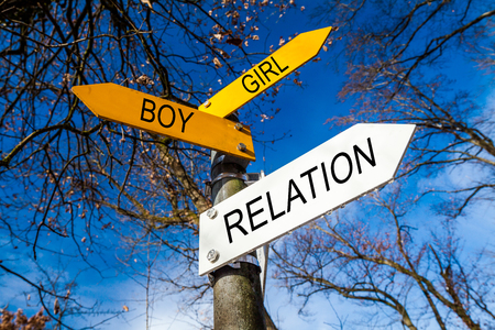 hetero: Yellow and white decision signs on a tree Stock Photo