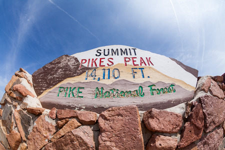 ​PIKES PEAK, COLORADO - AUGUST 26: Views of the Pikes Peak sign plate on top of the mountain on August 26, 2015. Pikes Peak is a famous mountain in the Rocky Mountains for hill races and recreation.