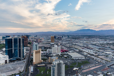 LAS VEGAS, NEVADA - SEPTEMBER 9: View of Las Vegas and the Las Vegas Strip from above on sunset on September 9, 2015. Las Vegas is known primarily for gambling, shopping and fine dining.