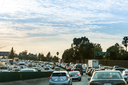 one lane street sign: VENTURA FREEWAY, SHERMAN OAKS - SEPTEMBER 11: Views of the traffic on the Ventura Freeway at sunset on September 11, 2015. The Ventura Freeway is a part of the Route 101, the longest in California. Editorial