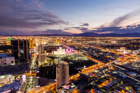 arial views: LAS VEGAS, NEVADA - SEPTEMBER 9: View of Las Vegas and the Las Vegas Strip from above on sunset on September 9, 2015. Las Vegas is known primarily for gambling, shopping and fine dining.