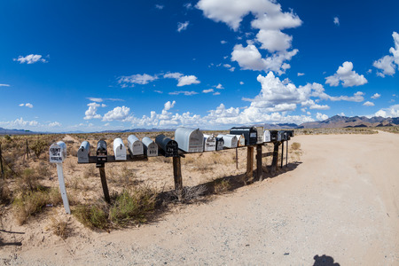 united states postal service: GOLDEN VALLEY, ARIZONA - SEPTEMBER 6: Views of mail boxes along the highway 93 on September 6, 2015. Mail boxes are popular photographic motives by tourist from foreign countries. Editorial