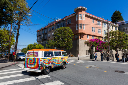 custom car: SAN FRANCISCO, CALIFORNIA - SEPTEMBER 17: View of the a painted car near Lombard Street in San Francisco on September 17, 2015. Custom hippie car rides are popular by tourist in San Francisco. Editorial