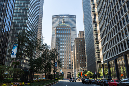 MANHATTAN, NEW YORK - SEPTEMBER 19: View to the Grand Central Terminal and the Met Life Building on September 19, 2015. This view is from the Sixth Avenue, also called the Park Avenue.