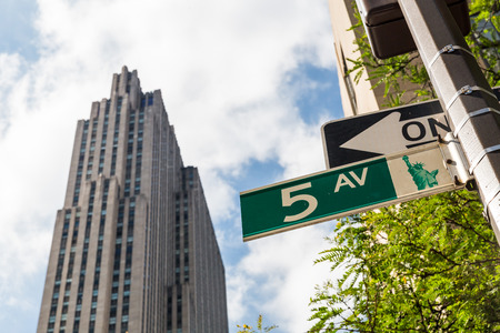 5th: MANHATTAN, NEW YORK - SEPTEMBER 19: View to the 5th Avenue street sign on September 19, 2015. This green streets signs are typical in cities all over the United States.