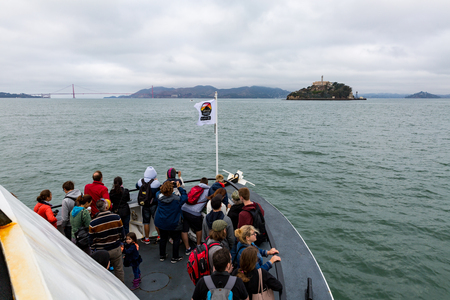 alcatraz: SAN FRANCISCO, CALIFORNIA - SEPTEMBER 17: View of the Alcatraz cruize boat and the tourist going to Alcatraz Island on September 17, 2015. Alcatraz was a federal prison from 1934 to 1963. Editorial