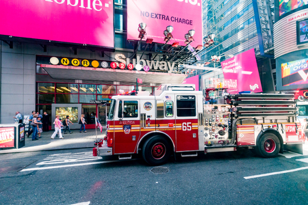 technical department: MANHATTAN, NEW YORK - SEPTEMBER 19: View of a fire truck at the Times Square on September 19, 2015. The Fire Department of New York provides fire protection, technical rescue and emergency services.