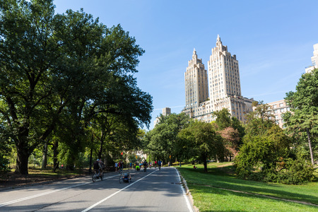 real renaissance: MANHATTAN, NEW YORK - SEPTEMBER 19: View to the The San Remo Building and Central Park on September 19, 2015. The Central Park was closed on this day for non motorized vehicles and pedestrians only.