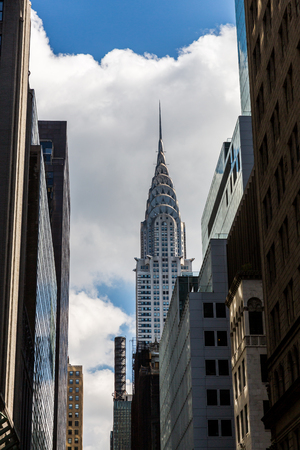 42nd: MANHATTAN, NEW YORK - SEPTEMBER 19: View to the Chrysler Building from the 42nd Street on September 19, 2015. The Chrysler Building is an Art Deco style skyscraper located on the East Side Manhattan.