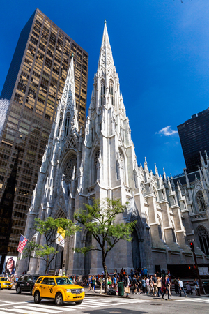 5th: NEW YORK - SEPTEMBER 19: View to the St. Patricks Cathedral in Midtown Manhattan with the famous 5th Avenue on SEPTEMBER 19, 2015. Its a decorated Neo-Gothic-style Roman Catholic cathedral church. Editorial