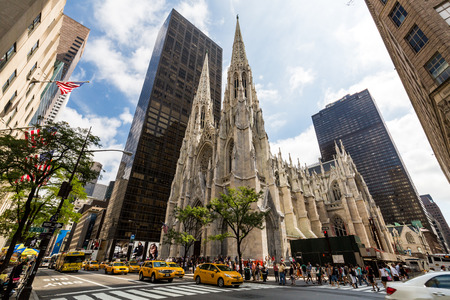 5th: NEW YORK - AUGUST 23: View to the St. Patricks Cathedral in Midtown Manhattan with the famous 5th Avenue on August 23, 2015. Its a decorated Neo-Gothic-style Roman Catholic cathedral church.
