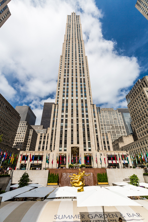 acres: ​​NEW YORK - AUGUST 23: Exterior views of to the Rockefeller center in Midtown Manhattan at the 5th Av on August 23, 2015. Rockefeller Center is a complex of 19 commercial buildings covering 22 acres.