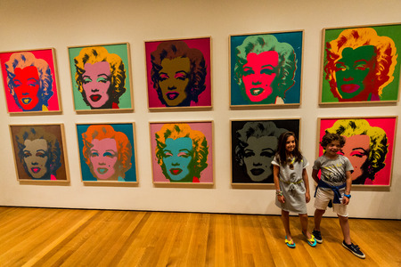monroe: NEW YORK, MUSEUM OF MODERN ART - AUGUST 23: A girl stands in the front of the famous Marilyn Monroe picture from Andy Warhole in the Museum of Modern Art in New York an August 23, 2015.