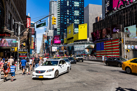 av: NEW YORK - AUGUST 22: View to the 8th Av from W33rd Street in New York on August 22, 2015. Its in the district of West Midtown, New York.
