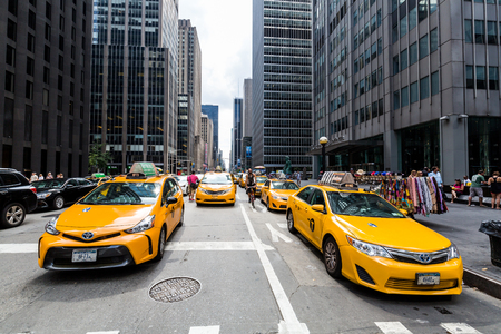 taxicabs: ​NEW YORK - AUGUST 23: View to New Yorks taxicabs at the 5th Av on August 23, 2015. The taxicabs of New York City are widely recognized icons of the city, come in two varieties: yellow and green. Editorial