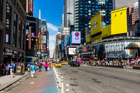 news stand: NEW YORK - AUGUST 22: View to the 8th Av from W42nd Street in New York on August 22, 2015. Its in the district of West Midtown, New York.