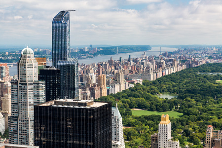 uptown: NEW YORK - AUGUST 23: View to Uptown Manhattan with the famous Central Park on August 23, 2015. This view is from the rooftop of an another skyscraper. Editorial