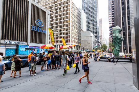 fifth avenue: NEW YORK - AUGUST 23: Views to the fast food stands at the Fifth Avenue, New York on August 23, 2015. Fast food stands are very popular in Manhattan New York. Editorial