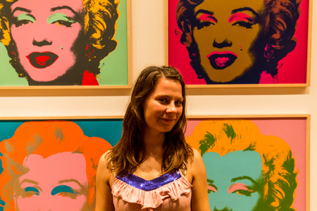marilyn: NEW YORK, MUSEUM OF MODERN ART - AUGUST 23: A girl stands in the front of the famous Marilyn Monroe picture from Andy Warhole in the Museum of Modern Art in New York an August 23, 2015.