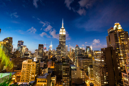 NEW YORK - AUGUST 23: View to Midtown Manhattan with the famous Empire State Building at sunset on August 23, 2015. This view is from the rooftop of the 230-fifth Bar. Editorial
