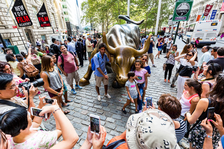 charging bull: NEW YORK - AUGUST 24: View to the bronze statue called Charging Bull in the financial district in Manhattan Downtown, New York on August 24, 2015. This statue is popular by tourist in New York.
