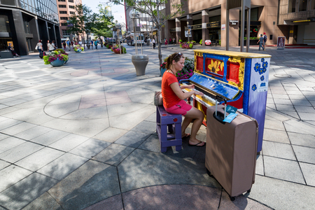 denver 16th street mall: ​DENVER, COLORADO - AUGUST 25: Views of the main shopping street 16th Street in Denver on August 25, 2015. On this street are free public buses driving and it provides lot of shopping opportunities.