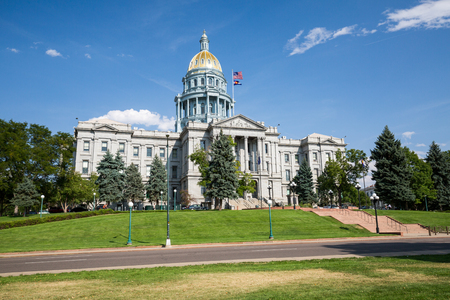 mile high city: DENVER, COLORADO - AUGUST 25: Views of the City Hall and Capitol Building of Denver Colorado on August 25, 2015. The architecture is similar to the main capitol building of USA in Washington D.C.