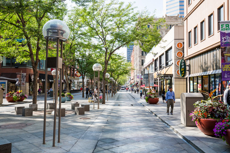 ​DENVER, COLORADO - AUGUST 25: Views of the main shopping street 16th Street in Denver on August 25, 2015. On this street are free public buses driving and it provides lot of shopping opportunities.
