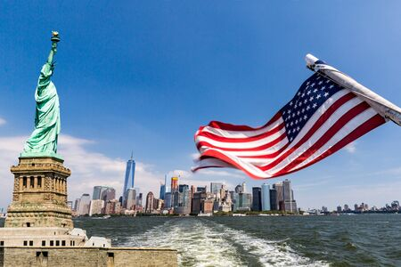 hudson river: View to Downtown Manhattan and the USA flag from Liberty Island, August 2015 Stock Photo