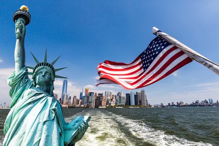 View to Downtown Manhattan and the USA flag from Liberty Island, August 2015 Stock Photo