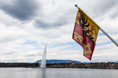 swimm: GENEVA, SWITZERLAND - APRIL 11: Exterior views of the buildings and fountain at the Geneva Lake on April 11, 2015. Its the second most populous city in Switzerland (after Zurich).