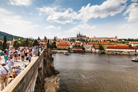 cz: PRAGUE, CZECH REPUBLIC - JULY 18: View to the Charles Bridge on July 18, 2015. Prague is the capital and largest city of the Czech Republic. Editorial