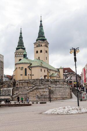 kilometres: ZILINA, SLOVAKIA - FEBRUARY 27: Main square in the city centre of Zilina on February 27, 2015. Zilina is a city in north-western Slovakia, around 200 kilometres (120 mi) from the capital Bratislava.