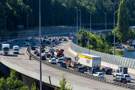 NEUENHOF, SWITZERLAND - JULY 21: Views of the motorway A1 near the Baregg Tunnel and the cities of Baden, Neuenhof and Wettingen on July 21, 2015. The motorway A1 ist the oldest in Switzerland.