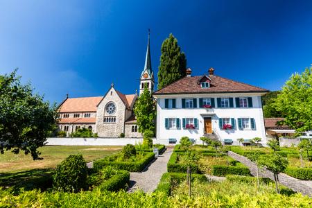 parish: WETTINGEN, AARGAU, SWITZERLAND - JULY 21: Exterior views of  the St. Sebastian Church of Wettingen on July 21, 2015. Wettingen is a municipality in the Swiss canton of Aargau.