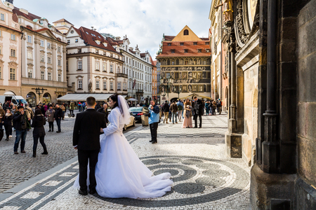 PRAGUE, CZECH REPUBLIC - FEBRUARY 26: View of a wedding photoshooting in front of the astronomical clock in Prague on February 26, 2016. Prague is the capitol city of Czech Republic.