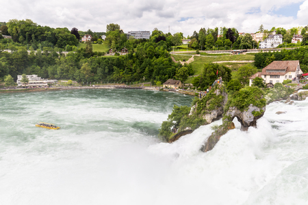 schweiz: RHEINFALLS, SWITZERLAND - MAY 17: View to the biggest waterfalls of Europe in Schaffhausen, Switzerland on May 17, 2015. They are 150 m (450 ft) wide and 23 m (75 ft) high. Editorial