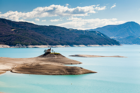 pres: Lake Serre-Poncon and a small church on a island, Hautes-Alpes, France