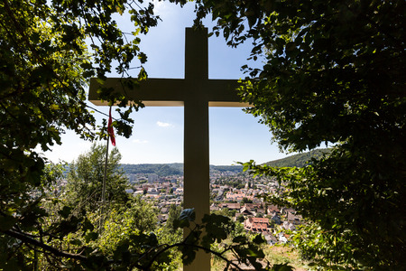 aargau: Views from the Mountain Sulperg with the white cross to the village of Wettingen on July 21, 2015. Wettingen is a municipality in the Swiss canton of Aargau.
